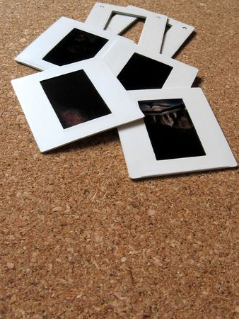 Photo slides and frames on a board