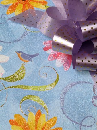 Close up view of a colorful gift box with bow