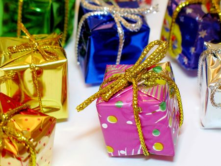 Colorful decorative mini gift boxes on white background, shallow DOF Stock Photo - 613733
