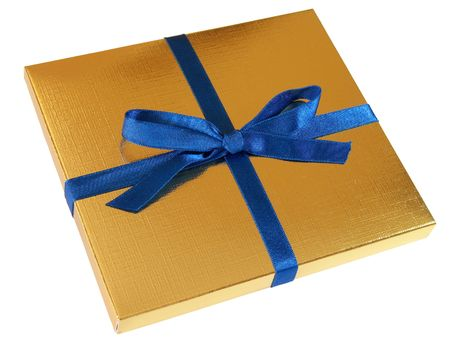 Close up view of a gold gift box with blue bow isolated on white background