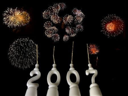 New Year celebration: candles showing year 2007 seen from below, with fireworks in the background Stock Photo