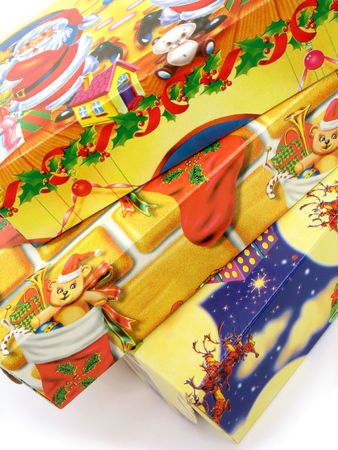 Close up view of a stack of three colorful Christmas gift boxes on white background Stock Photo