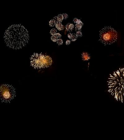 Composition of fireworks on black background, with copy space below. photo
