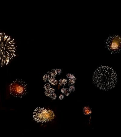 Composition of fireworks on black background, with copy space above. photo