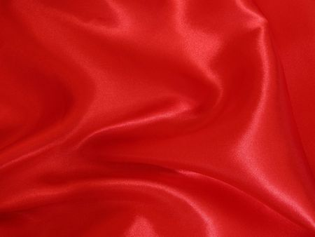 A loosely laid sheet of red satin.