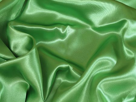 A loosely laid sheet of green satin.