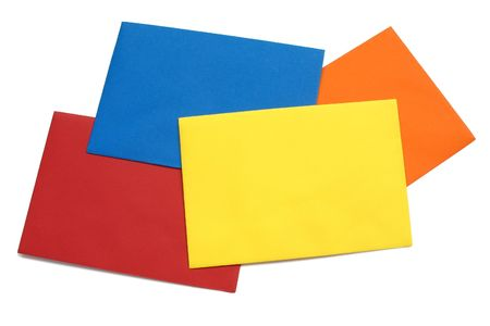 A series of four bright envelopes (red, blue, yellow and orange), isolated on white with natural shadows. Stock Photo