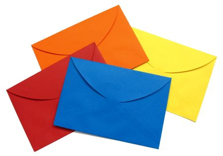 A series of four bright envelopes (red, blue, yellow and orange), backside view, isolated on white with natural shadows.