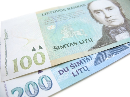 Close-up view of 100 and 200 Litas banknotes (Lithuanian currency) on white background, with selective focus on the 100. Stock Photo
