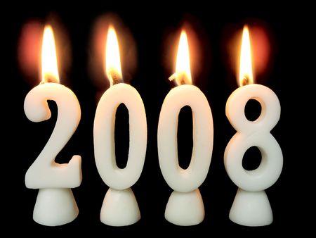 Capodanno 2008: la masterizzazione di candele mostrando anno 2008 su sfondo nero.  Archivio Fotografico