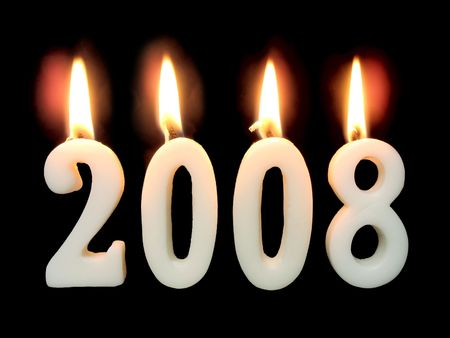 New Year 2008: burning candles showing year 2008 on black background.