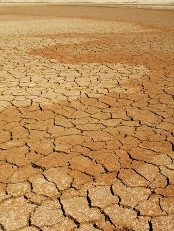 Cracked dry mud in lake bed during drought.  Concept for global warming and climate change. Taken in Namib-Naukluft National Park, Namibia.