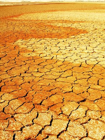 Cracked dry mud in lake bed during drought.  Altered colors for more dramaticity. Concept for global warming and climate change. Taken in Namib-Naukluft National Park, Namibia. Stock Photo