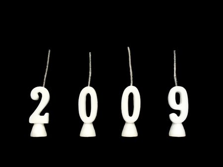New Year 2009: candles showing year 2009 on black background.