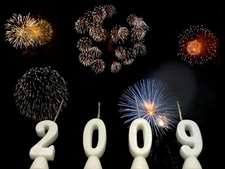 New Year 2009: candles showing year 2009 seen from below, with fireworks in the background