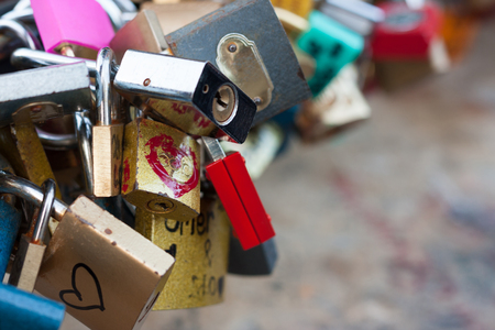 rust red: A bunch of love locks, with copy space