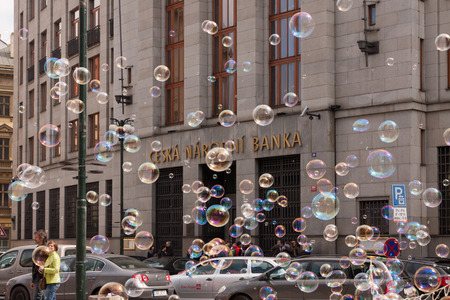 PRAGUE, CZECH REPUBLIC - APRIL 21, 2017: The building of the Czech National Bank, with colorful bubbles floating around