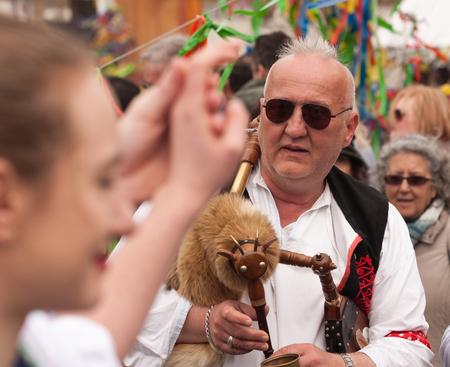 PRAGUE, CZECH REPUBLIC - APRIL 15, 2017: Easter at the Old Town Square - People in traditional Czech costumes play bagpipes and teach tourists how to dance