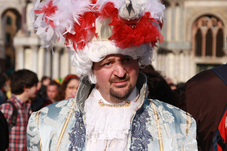 Man in a Venetian costume at the carnival in Venice, Italy, in front of the Basilica San Marco, 5th March 2011 Editorial