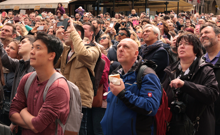PRAGUE, CZECH REPUBLIC - APRIL 15, 2017: Tourists watching the hourly show of the astronomical clock at the Old Town Square