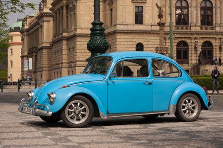 PRAGUE, CZECH REPUBLIC - APRIL 21, 2017: Vintage blue Volkswagen Beetle car, parked in front of the Rudolfinum concert hall