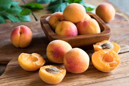 apricot kernels: Freshly harvested ripe apricots on a wooden table