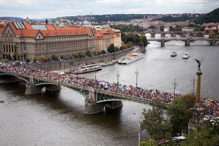 PRAGUE, CZECH REPUBLIC - AUGUST 12, 2017: Participants of the Prague Pride, a big gay & lesbian pride, are crossing one of the Vltava bridges