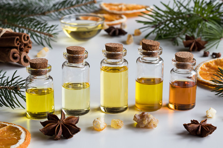selection of essential oils with christmas spices and ingredients bottles of essential oil spruce - Christmas Essential Oils