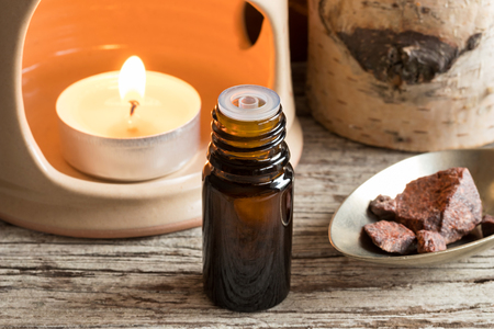 Croton lechleri (sangre de drago) oil with sangre de drago resin in the background Stock Photo