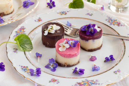 Raw vegan desserts with fresh violet and lungwort flowers
