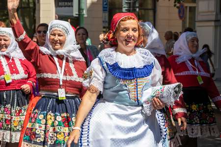 PRAGUE, CZECH REPUBLIC - JULY 1, 2018: Women in folk costumes at Sokolsky Slet, a once-every-six-years gathering of the Sokol movement - a Czech sports association