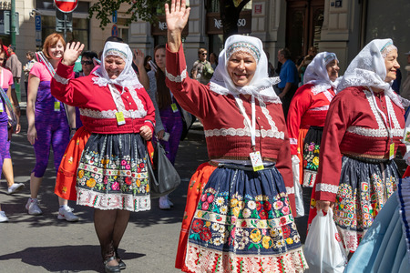 PRAGUE, CZECH REPUBLIC - JULY 1, 2018: Women in folk costumes parading at Sokolsky Slet, a once-every-six-years gathering of the Sokol movement - a Czech sports association
