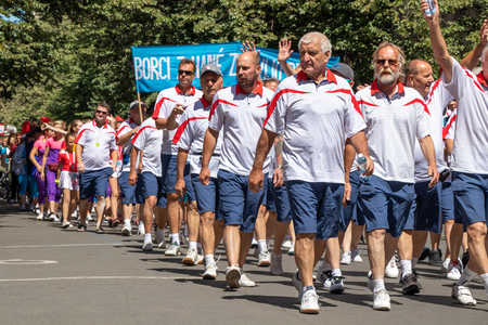 PRAGUE, CZECH REPUBLIC - JULY 1, 2018: Men parading at Sokolsky Slet, a once-every-six-years gathering of the Sokol movement - a Czech sports association 新聞圖片