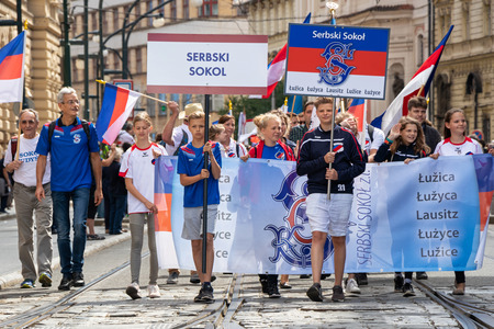 PRAGUE, CZECH REPUBLIC - JULY 1, 2018: Lusatian Sorbs parading at Sokolsky Slet, a once-every-six-years gathering of the Sokol movement - a Czech sports association 新聞圖片