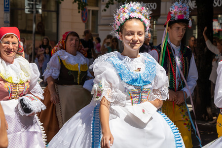 PRAGUE, CZECH REPUBLIC - JULY 1, 2018: People in Moravian folk costumes at Sokolsky Slet, a once-every-six-years gathering of the Sokol movement - a Czech sports association 新聞圖片