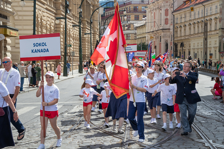 PRAGUE, CZECH REPUBLIC - JULY 1, 2018: Canadian visitors parading at Sokolsky Slet, a once-every-six-years gathering of the Sokol movement - a Czech sports association