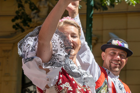 PRAGUE, CZECH REPUBLIC - JULY 1, 2018: People in Moravian folk costumes parading at Sokolsky Slet, a once-every-six-years gathering of the Sokol movement - a Czech sports association 新聞圖片
