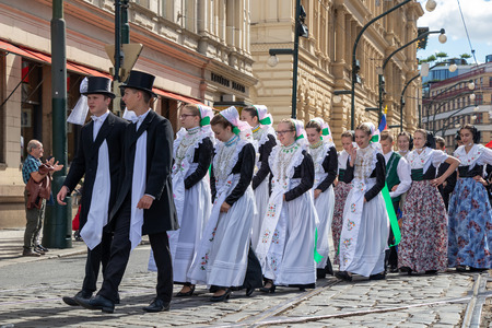 PRAGUE, CZECH REPUBLIC - JULY 1, 2018: People in folk costumes parading at Sokolsky Slet, a once-every-six-years gathering of the Sokol movement - a Czech sports association