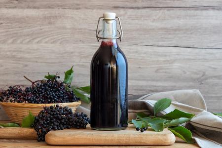 Black elder syrup, berries and leaves Stok Fotoğraf