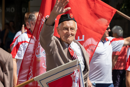 PRAGUE, CZECH REPUBLIC - JULY 1, 2018: Elderly man parading at Sokolsky Slet, a once-every-six-years gathering of the Sokol movement - a Czech sports association