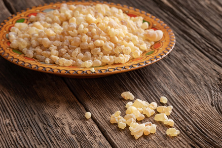 Frankincense resin crystals on a rustic background Stock Photo