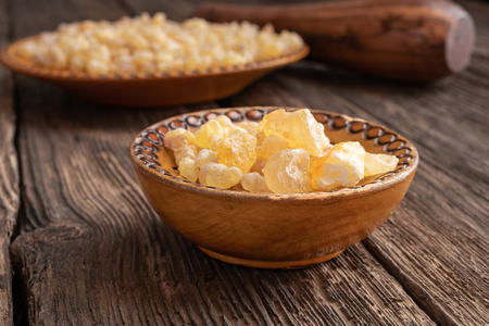 Frankincense resin crystals on a rustic background