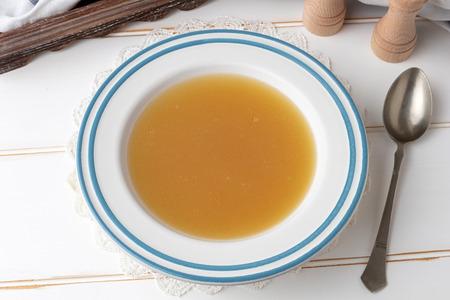 Chicken bone broth in a white plate Stock Photo