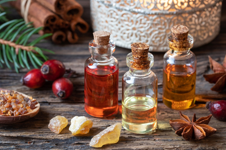 Christmas collection of essential oils with frankincense, myrrh and rose hips