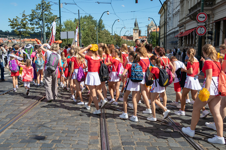 PRAGUE, CZECH REPUBLIC - JULY 1, 2018: Teenagers parading at Sokolsky Slet, a once-every-six-years gathering of the Sokol movement - a Czech sports association