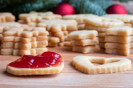 Traditional Linzer Christmas cookies are being filled with strawberry jam