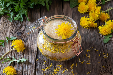 Preparation of homemade dandelion syrup from fresh flowers and cane sugar