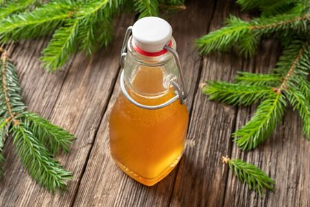 A bottle of homemade syrup against cough made from young spruce tips