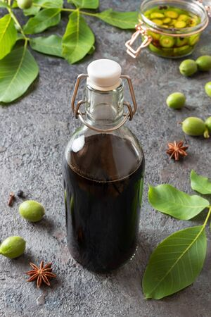 A bottle of homemade nut liqueur made from unripe walnuts and spices
