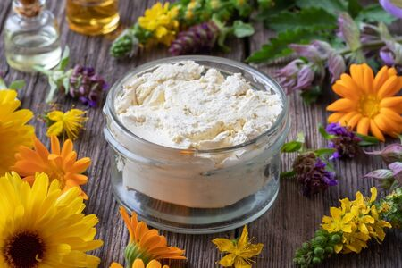Homemade skin cream made from raw unrefined shea butter, essential oils and medicinal herbs